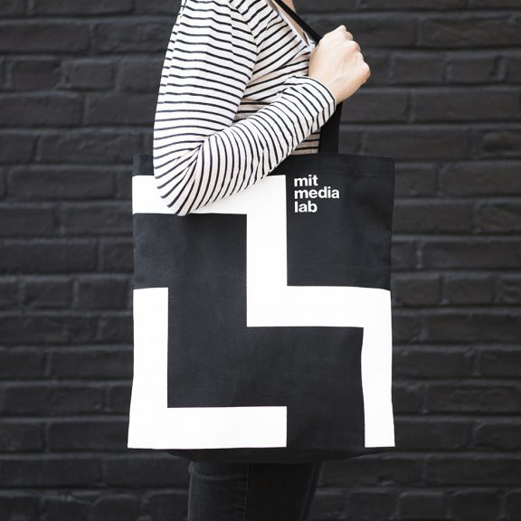 MIT media lab is an example of a flexible brand, displayed on a tote bag.