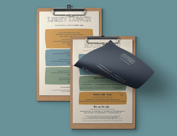White Hart pub menu on clipboard, as part of a larger branding project.