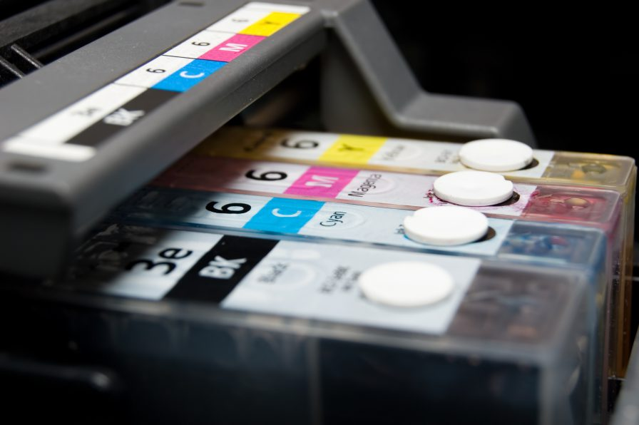 Printer ink cartridges in the four colour print process, or CMYK
